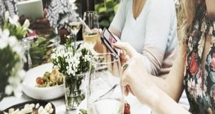 Group of women on their devices at brunch table.jpg